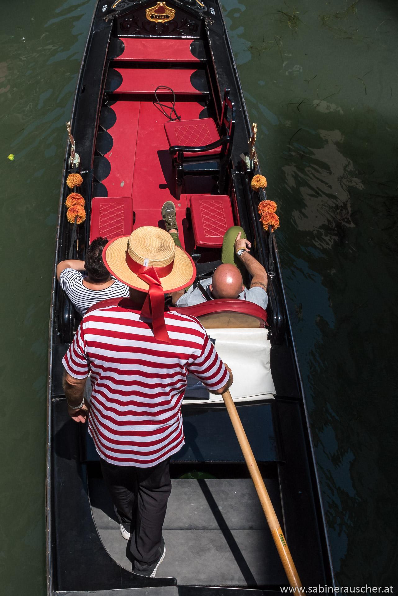 Venice - tourists enjoy Venice on board of a gondola | Venedig  - Touristen genießen Venedig vom Wasser aus